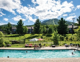 A sunny day at the outdoor pool at Jay Peak, Vt.
