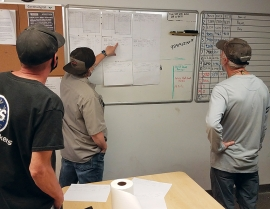 The Snowbird grooming team reviews the nightly slope log and KPI sheet.